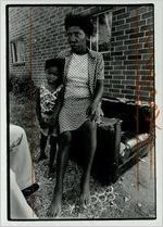 Aldora Stafford and her daughter Charlene outside their apartment in Mechanicsville, undated