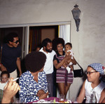 Smokey Robinson with Berry Gordy at his house party, Los Angeles