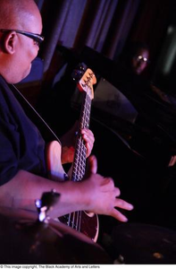 Bassist on stage Blue, Black, and Hot Dress Performance Theater Series