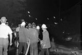 Fire fighters at work after a riot protesting the Freedom Riders' arrival in Montgomery, Alabama.