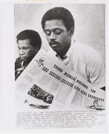 Stanley Wise and Ralph Featherstone of the SNCC displaying a newsletter at a press conference