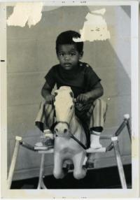Unidentified Young Boy on a Rocking Horse