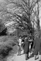 Gwen Patton and other students from Tuskegee Institute marching down a sidewalk during a demonstration to protest the murder of Samuel L. Younge, a civil rights worker.