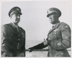 Captain James Pughsley, right, Chicago, Illinois, former adjutant with the 477th Bomber Group at Godman Field, Kentucky, is shown with Chief Warrant Officer Sylvester Trotte, left, aboard the U. S. Army Transport Algonquin enroute to the Mediterranean Theater