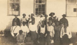 Group of African American women and children in front of a building.
