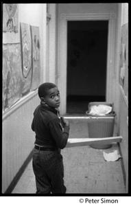 Young boy in a hallway: Liberation School, Boston, Mass.