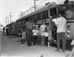 Children boarding school bus, Los Angeles, 1976