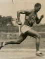Action photo of sprinter Ralph Metcalfe in full stride, 1932? - 1936?
