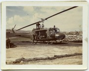 HU-1 (Huey) helicopter with Gunner putting the barrel on an M-60 machine gun at Camp Evans in Vietnam.
