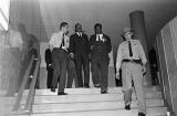 Martin Luther King Jr. and James Forman leaving the Montgomery County courthouse after a meeting with local officials in Montgomery, Alabama.