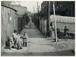 Children playing in the Defrees Alley, NE Washington, D.C.; Near Capitol Building; One basement room rents for $9.00 a month, two rooms upstairs for $ 16.00, one bath and cold water in the hall for entire building