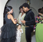 Gwen Gordy Fuqua talking with a couple at a party, Los Angeles