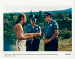 Reno Myerson answering questions of the state police at Hog Farm Camp in the mountains of New Mexico. 1968