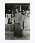 [Member of the International Sweethearts of Rhythm playing accordion]. [black-and-white photoprint]