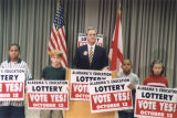 Governor Don Siegelman speaking at a podium, promoting the proposed education lottery.