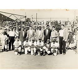 Ammon Recreational Center Little League baseball team players from B & M Restaurant, Elks, Pittsburgh Lions and Firemen's ...? team, with Dodgers' players Roy Campanella, Jackie Robinson, and Joe Black, possibly on opening day of the Hill District Little League, on Kennard Field