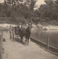 Woman and young girl in a carriage on the Cahaba River ferry in Cahaba, Alabama.