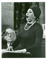 Leontyne Price singing at a podium with Claude Pepper sitting next to her
