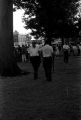 """Police officers and audience at a gathering in Canton Square in downtown Canton, Mississippi, during the """"March Against Fear"""" begun by James Meredith."""