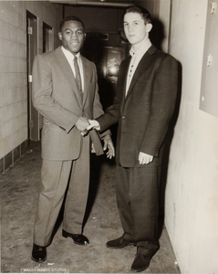 Two unidentified men in suits shaking hands