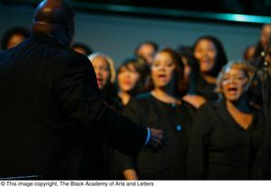 Choir director on stage Black Music and the Civil Rights Movement Concert, featuring Chrisette Michele and Ledisi