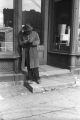 Jasper Wood Collection: Man leaning against doorway