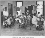 Learning to sew at the Gaudet School; [New Orleans, Louisiana.]