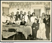 Group portrait of African Americans in dining room, Indianapolis, Indiana, circa 1935