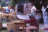 Lomia Nunn weaving a basket at the 1990 Alabama Folklife Festival in Birmingham, Alabama.