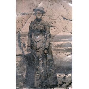 An African-American woman in a pleated skirt.