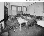 Group of African American men seated at tables in a Masonic Hall