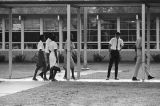 African American students entering Dixie Junior High School in Minor, Alabama, during the integration of the school.