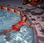 Gwen Gordy Fuqua in the pool at Berry Gordy's party, Los Angeles