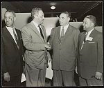 [Thurgood Marshall shaking hands with George Christopher, the mayor of San Francisco, as Roy Wilkins and R.J. Reynolds look on at 47th annual NAACP convention in San Francisco, June 26-July 1]