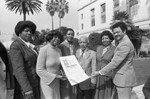Gilbert Lindsey, Robert Farrell and others posing with a Black History Month proclamation, Los Angeles, 1982