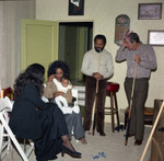 Diana Ross holding an infant at a party, Los Angeles, 1972