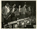 "[The ""Sweethearts"" saxophone section in performance, September, 1944.] [Black-and-white photoprint.]"