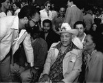 Berry Gordy, Joe Louis, and Diana Ross among a crowd, Las Vegas, 1979