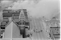 Aerial: Riots: Detroit: Race Riot. An aerial view of Grand River as buildings are consumed by fires.