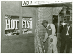Chitterling, fish and sugar cane on street in Negro Section, Clarksdale, Mississippi Delta; On a Saturday afternoon, November 1939
