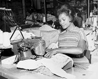 An ILGWU Local 105 woman sewing in a shop