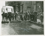 Group of Harlem youths recruited as street sweepers on 117th Street, ca. 1940s