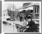 One week before his slaying, Malcolm X steps from his car in front of his fire-bombed house in East Elmhurst [N.Y.] on Sunday, Feb. 14