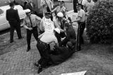 Protestors being arrested in front of the Capitol in Montgomery, Alabama, during a visit by Attorney General Robert Kennedy.