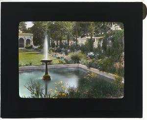 [Mrs. Eldridge Merick Fowler house, 363 Grove Street, Pasadena, California. Fountain in flower garden]