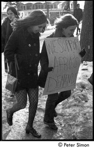 Women walking to protest, carrying sign: 'We support Afro's demands': white student support for Brandeis University African American student protest