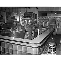 Interior of Crawford Grill No. 2 with tropical murals and mirrored piano on stage in center of bar