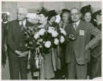 Mrs. Jessie Matthews Vann (center) holding a bouquet of flowers and flanked by C.C. Spaulding (left), president of the North Carolina Mutual Life Insurance Company, and Dr. Emmett J. Scott (right), of the Sun Shipbuilding Company, at the launching of Liberty ship SS Robert L. Vann