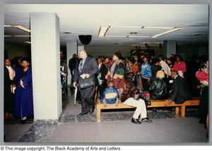 Photograph of a variety of people waiting to attend the concert Christmas/Kwanzaa Concert Hallelujah Hip Hop Concert, December 1995