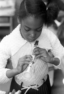 Black schoolchildren play recorders, Roxbury